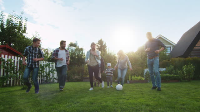 Family Paying Football in the Backyard. video