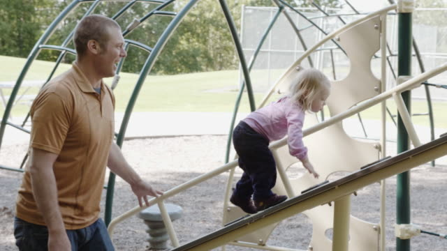 UHD 4K: Family playing and spending time together in a park video