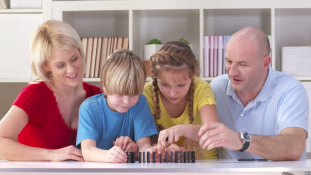 HD DOLLY: Family Playing Domino At Home video