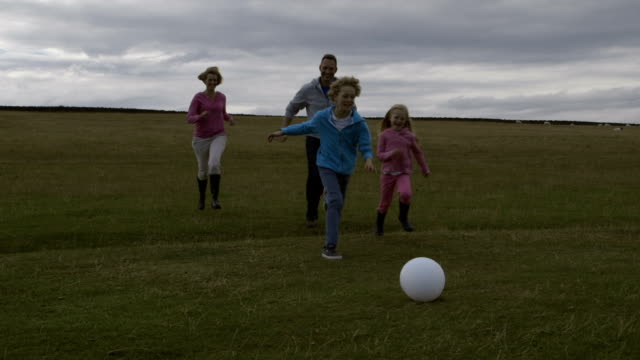 Family Playing Football video