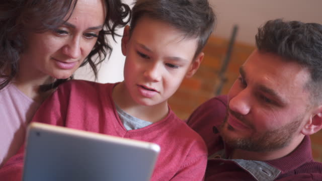 Family playing game on digital tablet video