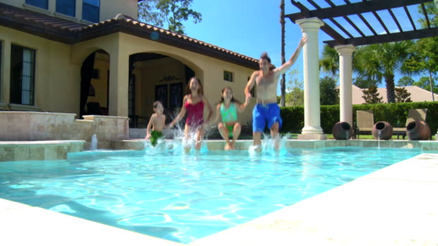 family pool lifestyle - affluent lifestyles stock videos & royalty-free footage
