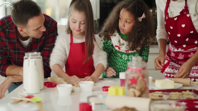 Family preparing christmas cookies in the kitchen
