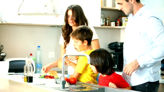 Family preparing food in a kitchen. video