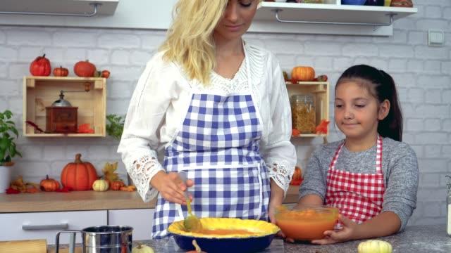 Family Preparing Pumpkin Pie