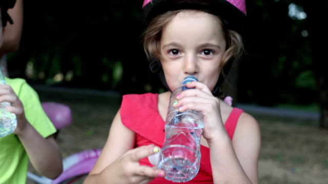 Family Refreshing with water after riding bicycles. video