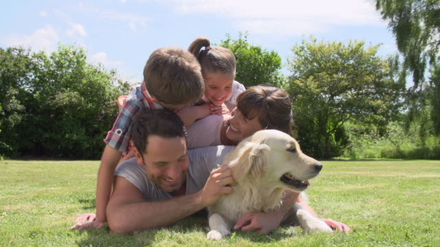 Family Relaxing In Garden With Pet Dog video
