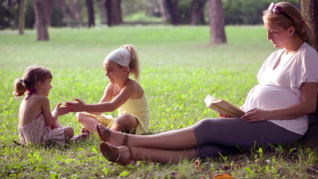 Family relaxing outdoor video