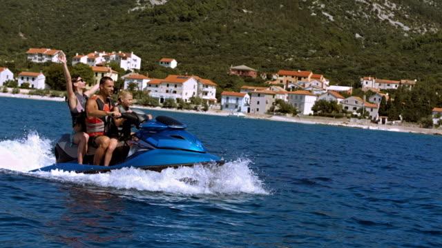 SLO MO Family Riding A Jet Boat Along The Coast video