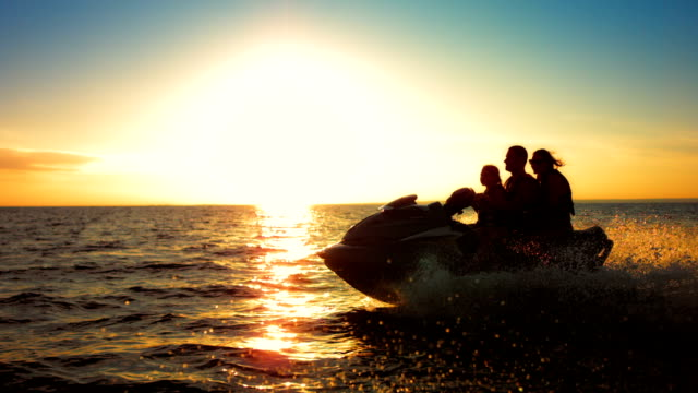 SLO MO Family Riding A Jet Boat At Sunset video