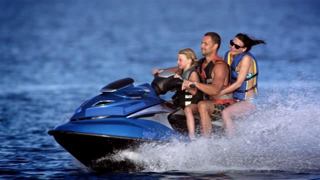 SLO MO Family Riding A Jet Boat