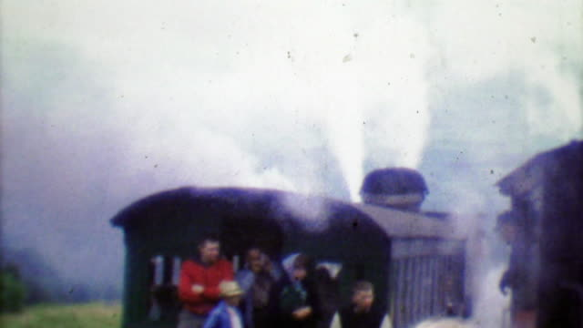 1964: Family riding Cog Railway on cloudy steamy gray day. video