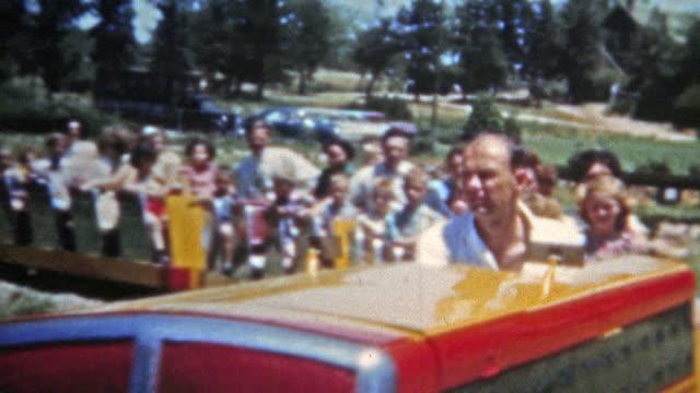 DENVER, COLORADO 1951: Family riding Elitch Gardens classic train ride video