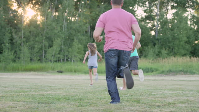 Family Running Together Outdoors video