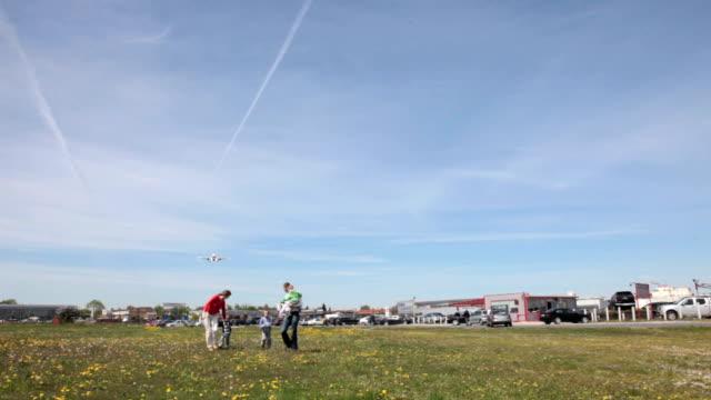 Family running under airplane landing video