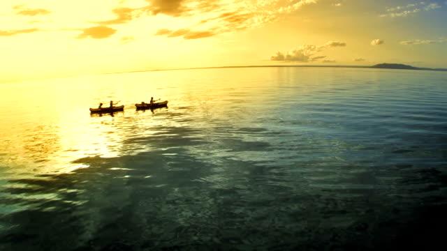 AERIAL Family Sea Kayaking At Dusk video