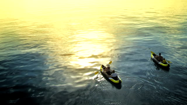 AERIAL Family Sea Kayaking At Sunset video