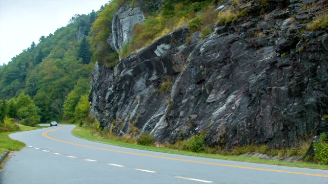 Family Sedan Driving on Blue Ridge Parkway Past Stone Wall video