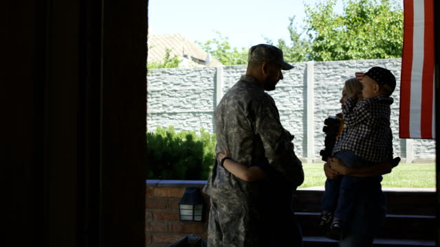 family sending soldier off to army - dividere video stock e b–roll