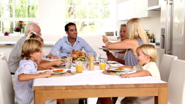 Family sharing holiday dinner video