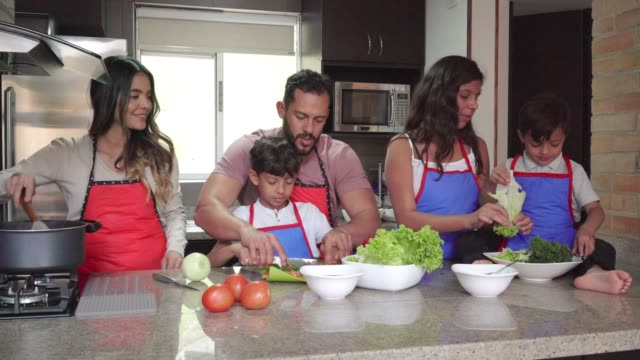 family sharing while cooking - cultura latino americana video stock e b–roll