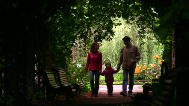 family silhouette in plant tunnel video