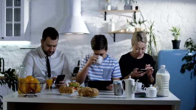 family sitting at the kitchen table - communication problems stock videos & royalty-free footage
