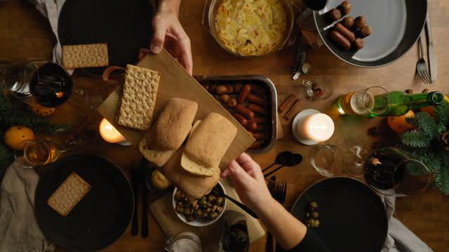 vídeos de stock e filmes b-roll de family sitting down for christmas dinner - meat plate