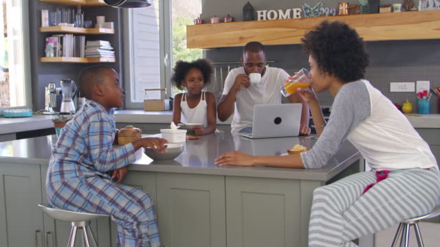 Family Sitting In Kitchen Enjoying Morning Breakfast Together video