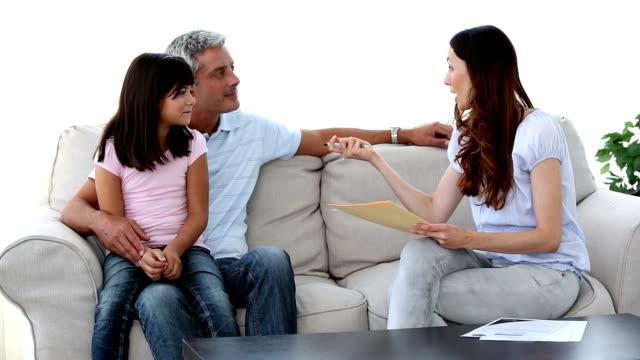family sitting on couch - 30 39 år bildbanksvideor och videomaterial från bakom kulisserna
