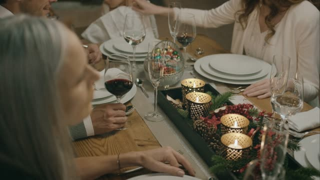 Family sitting on the table for christmas dinner. video