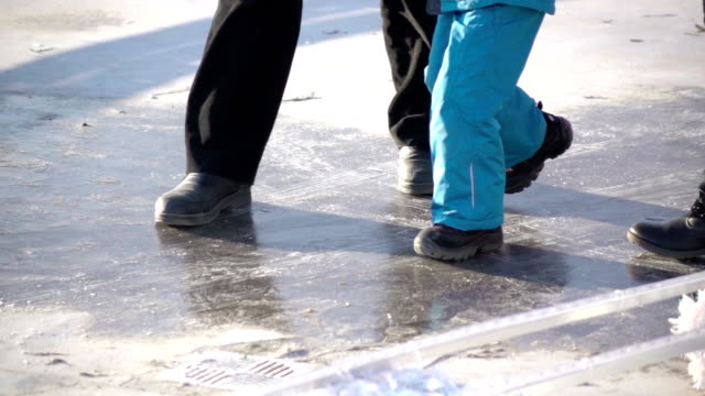 Family sliding on the ice video