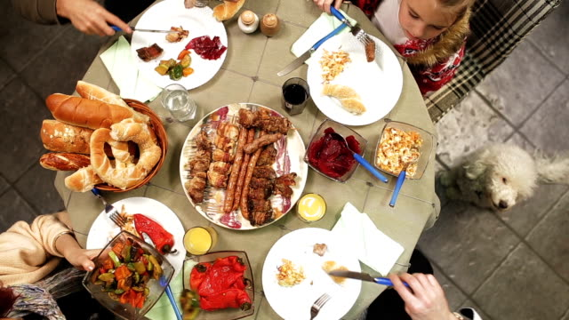 Family table with holiday foods video
