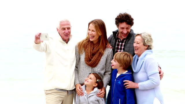 Family taking selfie together video