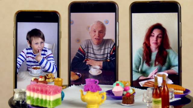 family tea party at the doll table via video calling video