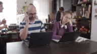 istock Family trying to work and learn at home 1217951952
