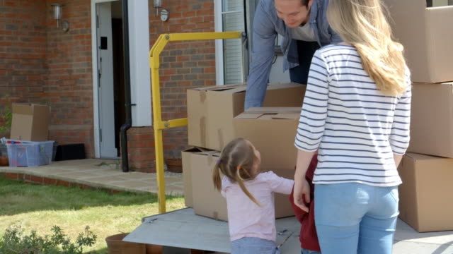 Family Unpacking Moving In Boxes From Removal Truck video