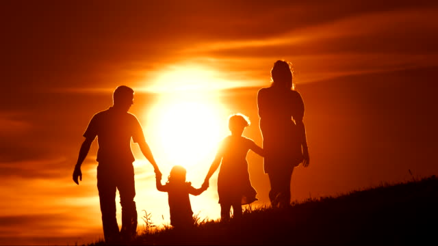 HD SLOW MOTION: Family Walking Across Meadow At Sunset video