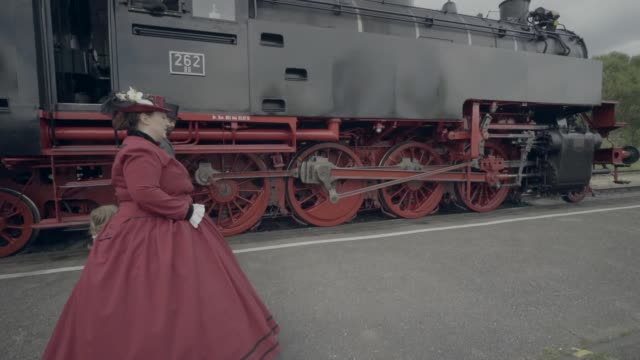 Family walking through train yard Victorian family visiting old train station 19th century style stock videos & royalty-free footage