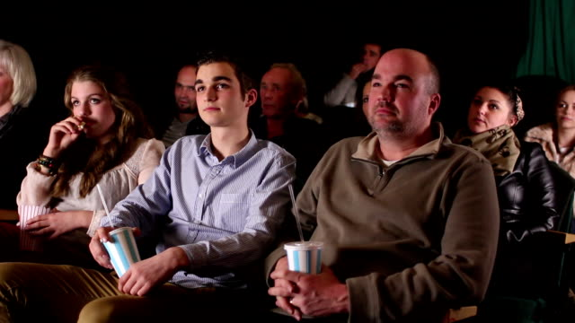 Family watching Comedy film at Cinema (DOLLY) video