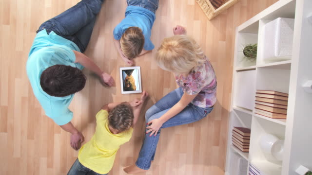 HD CRANE: Family Watching Photos On A Digital Tablet video