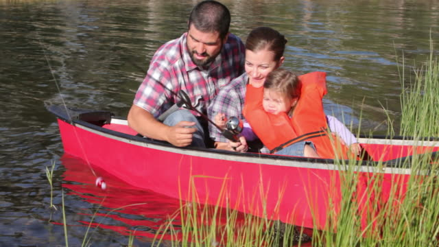 Family waves from canoe video