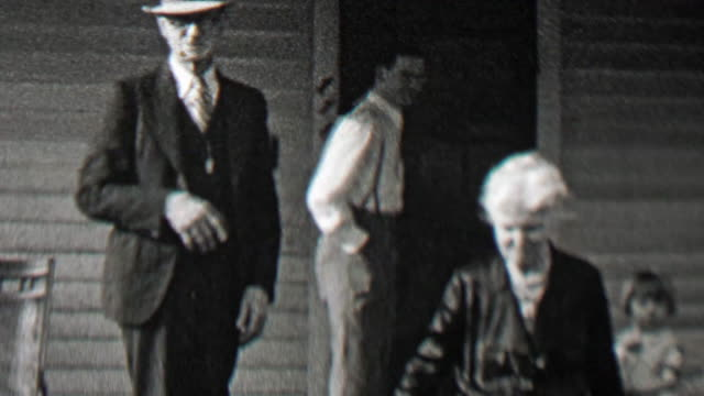 1938: Family welcomes visitors on front porch man waves hello. . porch stock videos & royalty-free footage