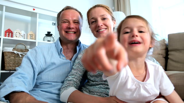 Family with Child Using Laptop Video Call Camera video