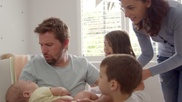 Family With Children And Newborn Son In Nursery video