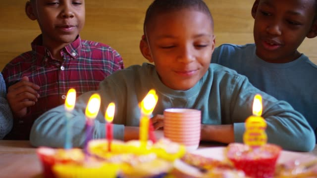 Family with five children celebrating birthday