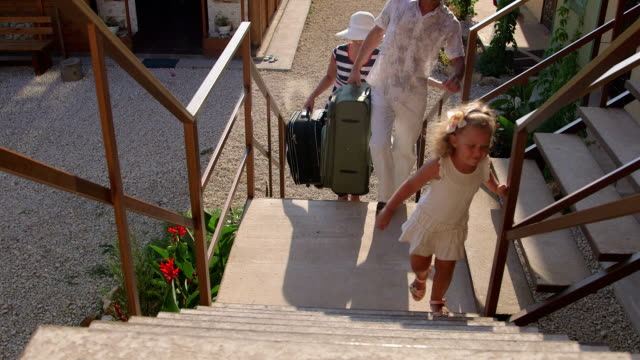 Family with luggage on summer holidays arrived in small tourist hotel Family with luggage on summer holidays arrived in small tourist hotel walking upstairs to the room house rental stock videos & royalty-free footage