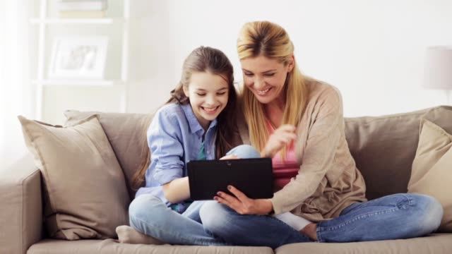 family with tablet pc having video chat at home - vídeo