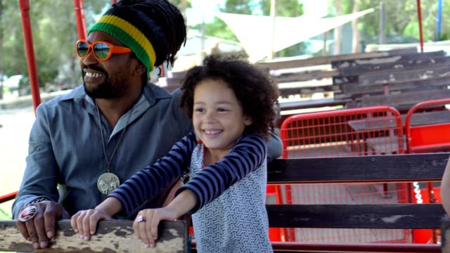 A family with two children visited an organic farm A family with two children visited an organic farm. Driving the carriage and view different kinds of animals. locs hairstyle stock videos & royalty-free footage
