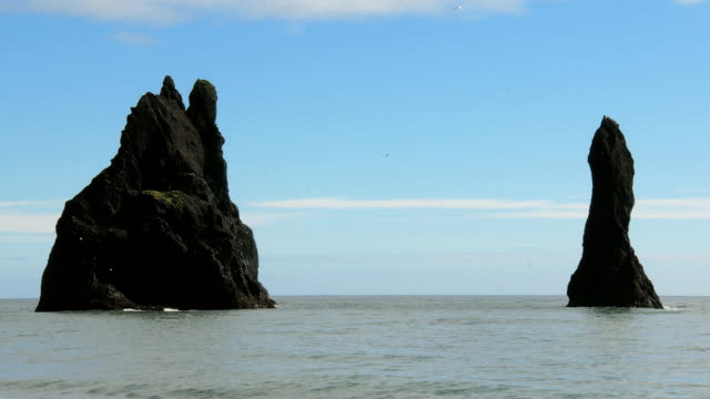 famous basalt cliff Fingers of Troll,not far from black sand beach Reynisfjara and Vik in Iceland video